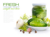 Preparing preserves of pickled cucumbers in jar with spices and herbs — Stock Photo
