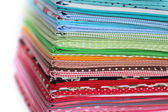 Pile of colorful cotton textile background — Stock Photo