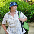 Middle-aged female tourist with a backpack — ストック写真