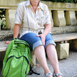 Middle-aged tourist with a backpack - Stok fotoğraf