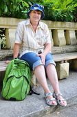 Middle-aged tourist with a backpack — Stock Photo