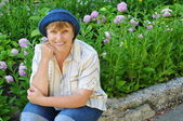 Middle-aged woman in a garden — Stock Photo