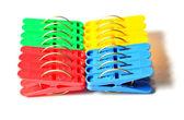 Bright-colored plastic pegs — Stock Photo
