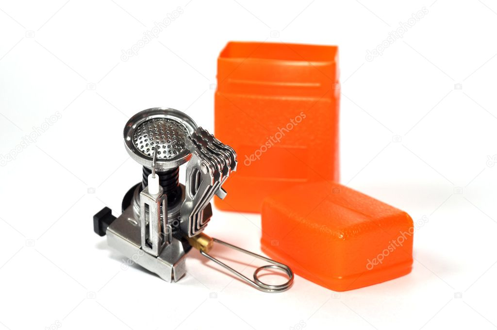 Portable gas burner with piezo igniter and an orange plastic box isolated on the white background — Stock Photo #12028271