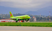 Boeing-737-800, passenger airliner of S7 airlines («Siberia») on the platform of the International Sochi airport on August 16, 2012 in Sochi, Russia — Stock Photo