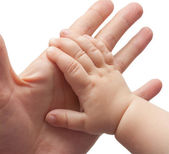 Father's and baby's hands — Stock Photo