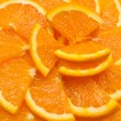 Stock Photo: Hi res orange slices background