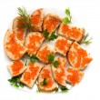 Red caviar on bread with parsley — Stock Photo