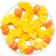 Tangerines with pineapple on a white background — Stock Photo