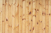 Piece of new wooden yellow fence — Stock Photo