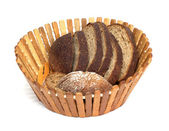 Black bread on board on white background — Stock Photo