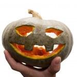 Hand holding halloween pumpkin — Stock Photo