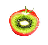 Kiwi in tomato — Stock Photo
