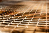 Rusty grid as a background — Stock Photo