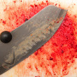 Bloody background with a knife — Stock Photo