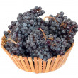 Black grapes in a basket on a white background - Stockfoto