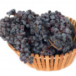 Black grapes in a basket on a white background - Lizenzfreies Foto