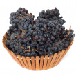 Black grapes in a basket on a white background - Stock Photo