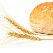 Wheat and bread on a white background — Stock Photo #12191409