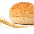 Wheat and bread on a white background — Stock Photo #12191421