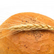 Bread and wheat on a white background — Stock Photo #12191493