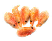 Red frozen shrimp on a white background — ストック写真