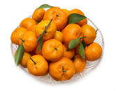 Oranges with leaves on a plate — Stockfoto