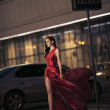 Stock Photo: Sexy beauty woman in fluttering red dress - motion shot