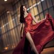 Sexy young beauty woman in fluttering red dress — Stock Photo #11120921