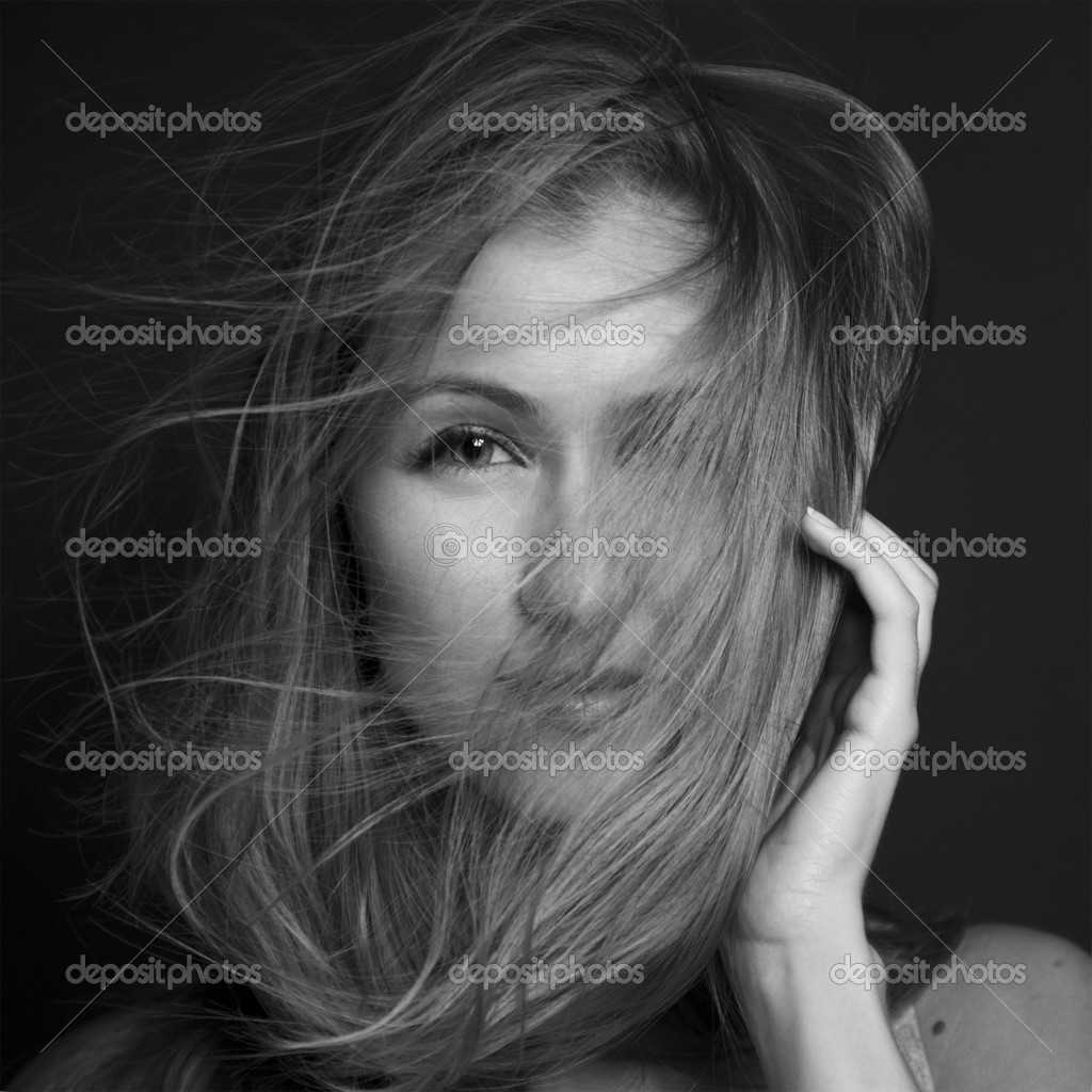 Wellness and spa. Sensual woman model with windswept flying hair on dark background. Shiny long health hairstyle. Beauty and haircare  Stock Photo #12143554