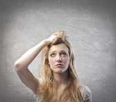 Young woman with doubtful expression — Stock Photo