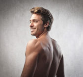 Smiling handsome brawny young man — Stock Photo