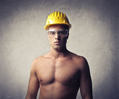 Young worker wearing a security cap — Stock Photo