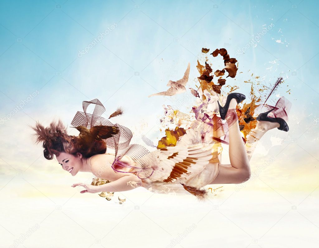 A gorgeous woman is falling from the sky. — Stock Photo #11396158
