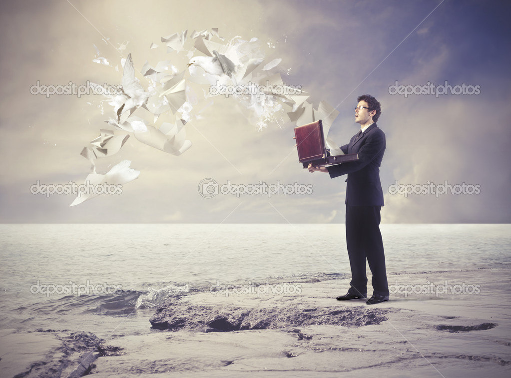 A businessman is doing his papers fly away. — Stock Photo #11396197