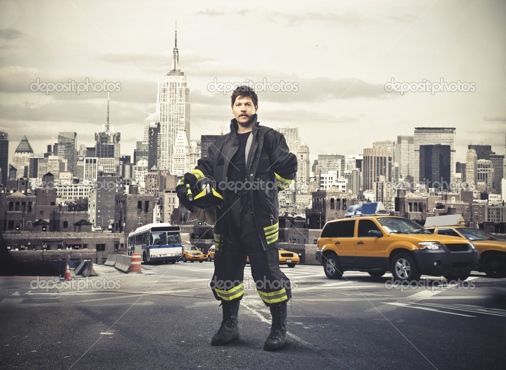 A New York's fireman in a parking. — Stock Photo #11456211