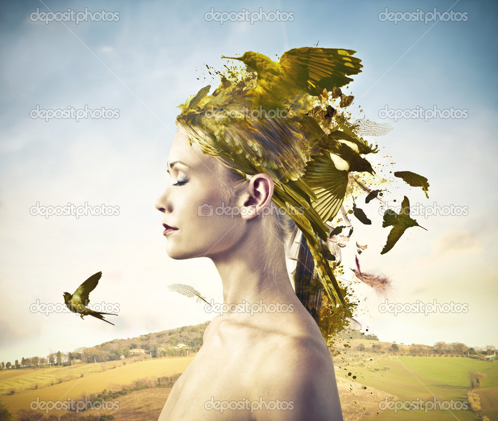 Some gold birds are over the head of a beautiful woman.  Stock Photo #11993089