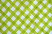 Background Of Green Checked Material — Stock Photo
