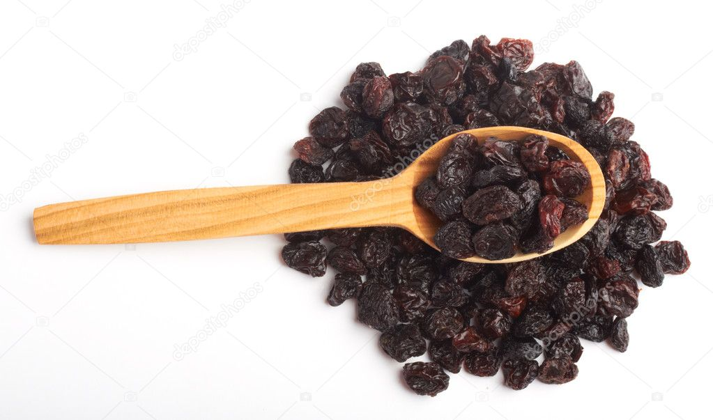 Dark raisin in wooden spoon — Stock Photo #11908385