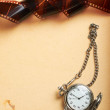 Retro album page with vintage clock with chain — Stock Photo