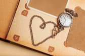 Retro album page with vintage clock with chain — Zdjęcie stockowe