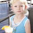 Portrait of little girl with a glass of cocktail — Stock Photo #10764532