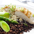 Butterfish with green lentils, leek and green asparagus - Stock Photo