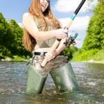 Woman fishing in river, Czech Republic — Stock Photo
