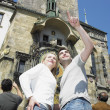 Stock Photo: Couple in Prague, Horloge, Old Town Hall, Czech Republic