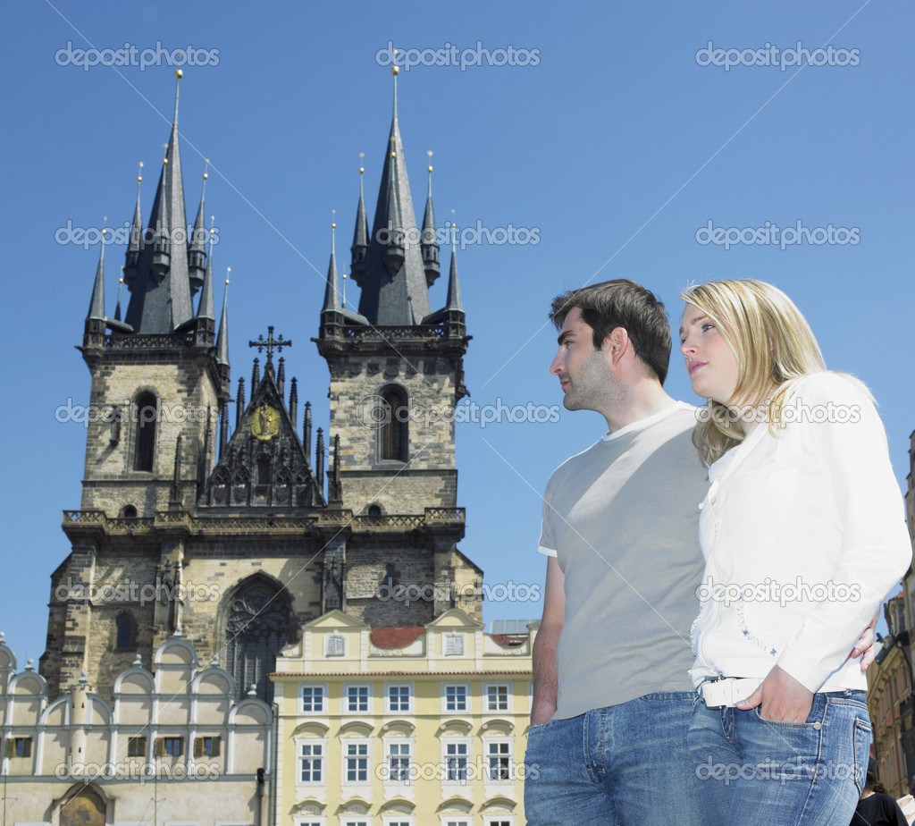 Couple in Prague, Tynsky church, Old Town Square, Czech Republic  Stock Photo #10823621