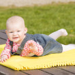 Lying down baby girl — Stock Photo