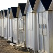 Stock Photo: Huts on beach, Bernieres-s-Mer, Normandy, France