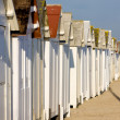 Huts on the beach, Bernieres-s-Mer, Normandy, France - Stock Photo