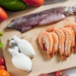 Still life of raw seafood and vegetables — Stock Photo #10986417